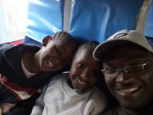 Machas Matatu EVOLVE Macha and his kids in the bus